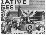 1961, President John F. Kennedy and the ILGWU Housing Project. ER with President Kennedy speaking, Governor N. Rockefeller (left) and D. Dubinsky, president, ILGWU, (right of JFK). Franklin D. Roosevelt Presidential Library
